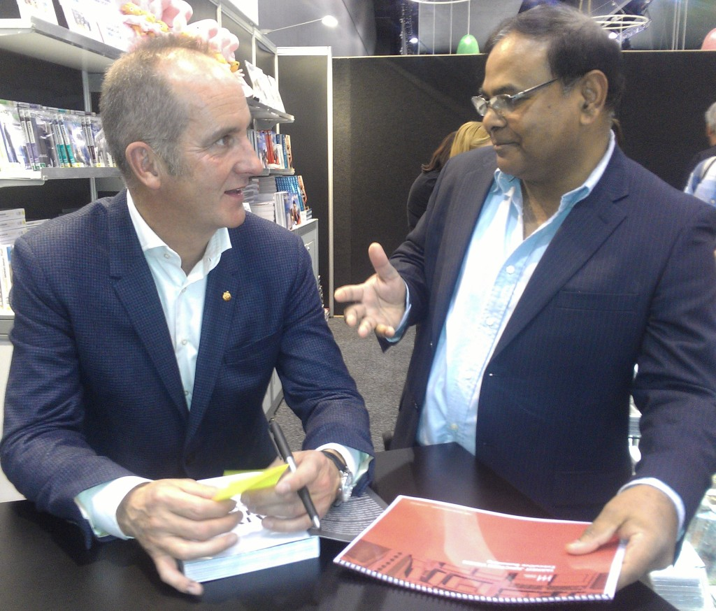 Sunil with Kevin McCloud of great design discussing Tarneiit Junction Project